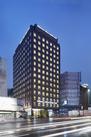 外観は、日本の伝統的な「織(おり)」をモチーフにしたデザイン。ランドマーク性の高い、存在感のある建物を目指しました。